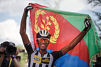 Daniel Teklehaimanot (ERI/MTN-Qhubeka) crosses the finish line 7th today and is received as a winner by a group of Eritrean fans who reach him a national flag to celebrate his result.<br /> <br /> stage 16: Bourg de Péage - Gap (201km)<br /> 2015 Tour de France