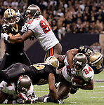 December 2009: New Orleans Saints linebacker Jonathan Vilma (51) tackles Tampa Bay Buccaneers running back Cadillac Williams (24) during an NFL football game at the Louisiana Superdome in New Orleans.  The Buccaneers defeated the Saints 20-17.