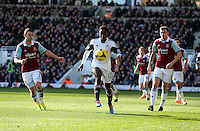 Pictured: Nathan Dyer of Swansea (C) controls the ball between Matt Jarvis (L) and George McCartney (R) of West Ham. 01 February 2014<br /> Re: Barclay's Premier League, West Ham United v Swansea City FC at Boleyn Ground, London.