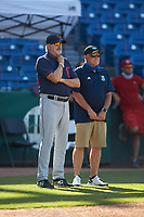 Cleveland Indians scout Bob Mayer (left) watches a video on the scoreboard prior to the start of game six of the East Coast Pro Showcase at the Hoover Met Complex on August 3, 2020 in Hoover, AL. (Brian Westerholt/Four Seam Images)