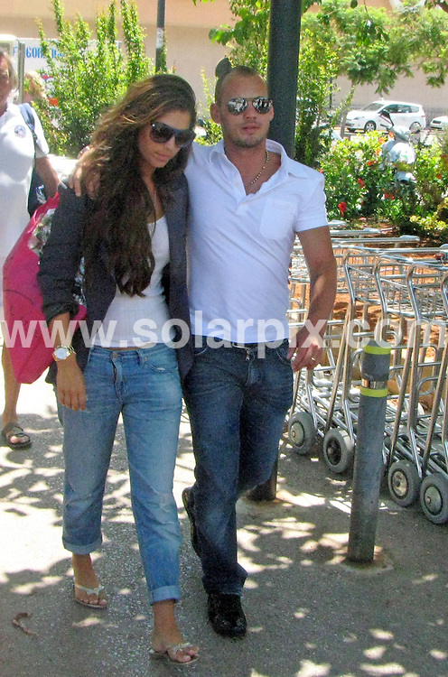 **ALL-ROUND PICTURES FROM SOLARPIX.COM**.**SYNDICATION RIGHTS FOR UK, AUSTRALIA & NEW ZEALAND ONLY**.Inter Milan player Wesley Sneijder and girlfriend Yolanthe Cabau van Kasbergen were seen arriving in Ibiza, Spain. 27 July 2010.This pic: Wesley Sneijder and Yolanthe Cabau van Kasbergen..JOB REF: 11782 SKX      DATE: 27_07_2010.**MUST CREDIT SOLARPIX.COM OR DOUBLE FEE WILL BE CHARGED**.**MUST NOTIFY SOLARPIX OF ONLINE USAGE**.**CALL US ON: +34 952 811 768 or LOW RATE FROM UK 0844 617 7637**