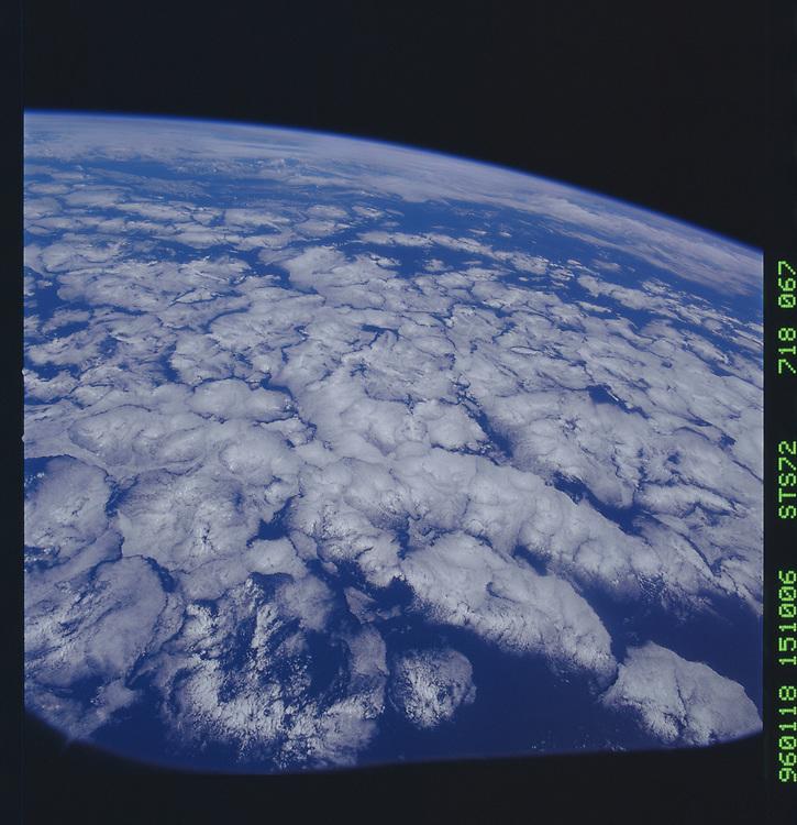 John Angerson. STS-72 Book.<br /> Public Domain Image.<br /> NASA images Courtesy National Archives - Record Group number: 255-STS-STS072<br /> Description: Earth observations taken from shuttle orbiter Endeavour during STS-72 mission.<br /> <br /> Subject Terms: STS-72, ENDEAVOUR (ORBITER), EARTH OBSERVATIONS (FROM SPACE), EARTH LIMB<br /> <br /> Date Taken: 1/18/1996<br /> <br /> Categories: Earth Observations<br /> <br /> Interior_Exterior: Exterior<br /> <br /> Ground_Orbit: On-orbit<br /> <br /> Original: Film - 70MM CT<br /> <br /> Preservation File Format: TIFF<br /> <br /> geon: PACIFIC OCEAN<br /> <br /> feat: SUNGLINT, CLOUDS<br /> <br /> tilt: Low Oblique<br /> <br /> cldp: 80<br /> <br /> nlat: 3.2<br /> <br /> nlon: -127.7<br /> <br /> azi: 111<br /> <br /> alt: 166<br /> <br /> elev: 4