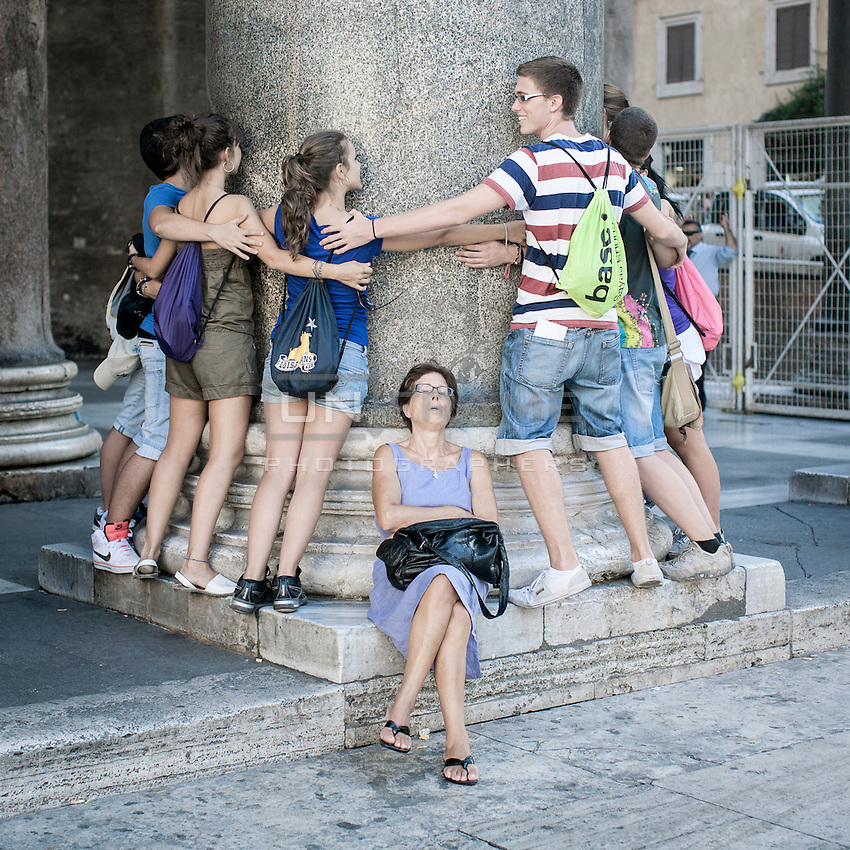 A group of students on a school trip at the Pantheon's Square, Rome.