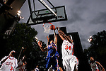 Michael Beasley (30) goes up for a rebound with Donte Greene (34) during the Elite 24 Hoops Classic game on September 1, 2006 held at Rucker Park in New York, New York.  The game brought together the top 24 high school basketball players in the country regardless of class or sneaker affiliation.