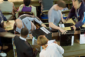 Council staff count ballot papers in Camden Town Hall, London, on the night of the 2005 General Election.
