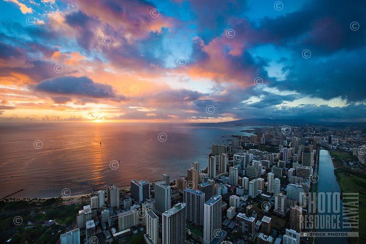 An epic sunset in front of Waikiki hotels, Honolulu, O'ahu.