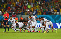 Costa Rica celebrate winning the penalty shoot out and qualifying for the quarter finals