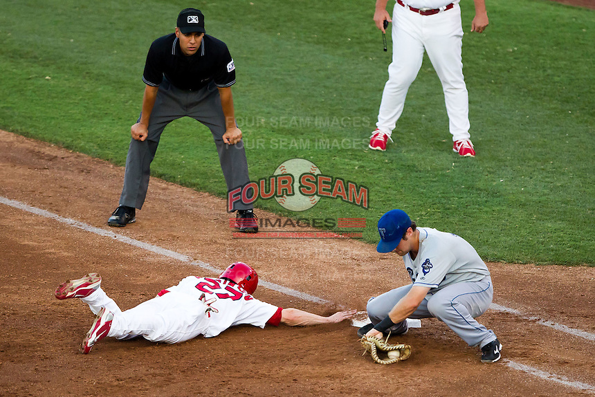 Shane Robinson (27) of the Springfield Cardinals slides back into first base during a game against the Tulsa Drillers at Hammons Field on July 20, 2011 in Springfield, Missouri. Springfield defeated Tulsa 12-1. (David Welker / Four Seam Images)