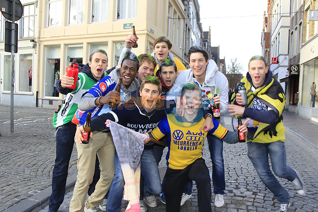 Boisterous fans before the start of the 96th edition of The Tour of Flanders 2012 in Bruges Market Square, running 256.9km from Bruges to Oudenaarde, Belgium. 1st April 2012. <br /> (Photo by Eoin Clarke/NEWSFILE).