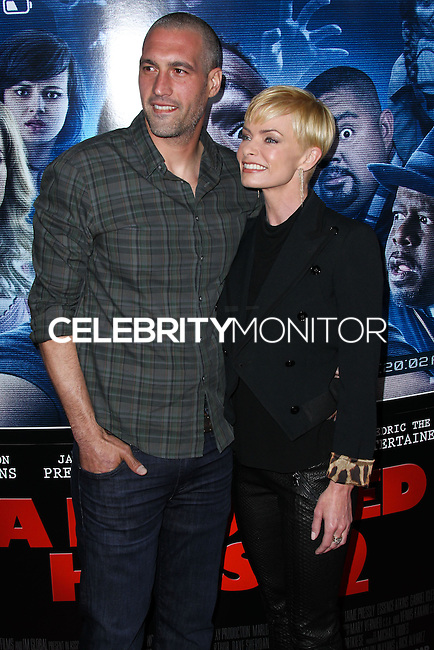 """LOS ANGELES, CA, USA - APRIL 16: Hamzi Hijazi, Jaime Pressly at the Los Angeles Premiere Of Open Road Films' """"A Haunted House 2"""" held at Regal Cinemas L.A. Live on April 16, 2014 in Los Angeles, California, United States. (Photo by Xavier Collin/Celebrity Monitor)"""