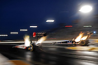 Jul, 8, 2011; Joliet, IL, USA: NHRA top fuel dragster driver Shawn Langdon (left) alongside David Grubnic during qualifying for the Route 66 Nationals at Route 66 Raceway. Mandatory Credit: Mark J. Rebilas-