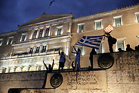 Pictured: Protesters on the steps of the Parliament Thursday 18 May 2017<br /> Re: Clashes between anti fourth memorandum protesters and riot police in front of the Parliament building in Syntagma Square, Athens, Greece