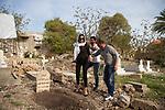 """Shooting of the series """"Jareemat Shaghaf"""" (""""Passionate Crime""""), Lebanon mars 2016 (Media 7 revolution). The actress Nadine El Rasi in preparing for a prayer scene at the cemetery. The plate has been inscribed for the scene, but the shooting is in a real cemetery.<br /> <br /> Tournage de la série la série """"Jareemat Shaghaf"""" (""""Crime Passionnel"""") Liban, Mars 2016 (Media revolution 7). L'actrice Nadine El Rasi est préparée pour une scène de prière au cimetière. La plaque de la tombe a été gravée pour la scène, tandis que le tournage se déroule dans un vrai cimetière."""
