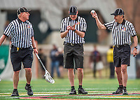 18 April 2015:  NCAA Lacrosse Officials stand at midfield during a game between the University of Vermont Catamounts and the University of Hartford Hawks at Virtue Field in Burlington, Vermont. The Cats defeated the Hawks 14-11 in the final home game of the 2015 season. Mandatory Credit: Ed Wolfstein Photo *** RAW (NEF) Image File Available ***
