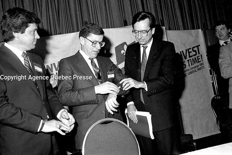Montreal, CANADA, January 20 1985 File Photo - Gerard D. Levesque attend the Liberal Party of Quebec convention and give the time to r Robert Bourassa (R)
