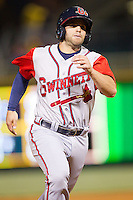 Tommy La Stella (11) of the Gwinnett Braves hustles towards third base against the Charlotte Knights at BB&T Ballpark on April 16, 2014 in Charlotte, North Carolina.  The Braves defeated the Knights 7-2.  (Brian Westerholt/Four Seam Images)