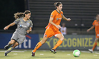 Sky Blue midfielder, Yael Averbuch (13) turns upfield with Philadelphia midfielder, Tina DiMartino (25) in pursuit.  The Philadelphia Independence scored three first half goals, and went on to win 4-1 over Sky Blue at John A Farrell Stadium in West Chester, Pennsylvania.