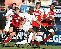 Darlington Naqbe #6 of the University of Akron gets away from Paolo DelPiccolo #3 of the University of Louisville during the 2010 College Cup final at Harder Stadium, on December 12 2010, in Santa Barbara, California.Akron champions, 1-0.
