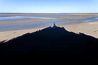 France, Manche, Mont Saint Michel bay, listed as World Heritage by UNESCO, The Mont SSaint Michel, shadow of the Mont-Saint Michel on the bay // France, Manche (50), Baie du Mont Saint-Michel, classée Patrimoine Mondial de l'UNESCO, Le Mont Saint-Michel, ombre du mont Saint-Michel sur la baie