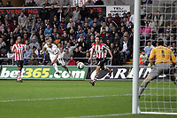 Pictured: Thomas Butler of Swansea (2nd L) scoring the third goal for his team in the second half while watched by Lloyd James (3rd L) and another Southampton player.<br />
