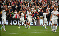 Pictured: Jack Cork and Jonjo Shelvey of Swansea (C) thank home supporters after the end of the game Sunday 30 August 2015<br /> Re: Premier League, Swansea v Manchester United at the Liberty Stadium, Swansea, UK