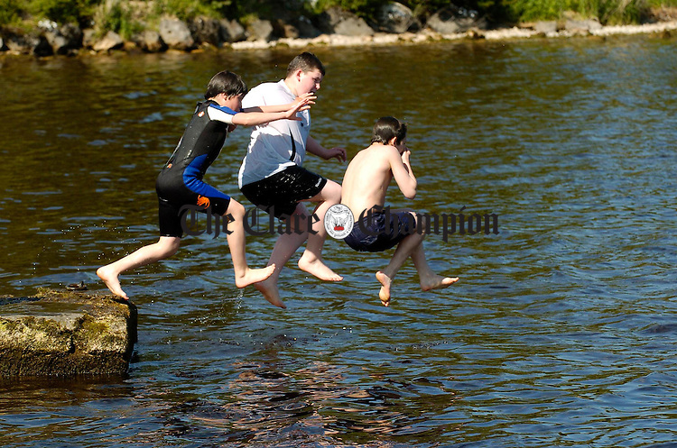Local children take the plunge at Mountshannon harbour. Photograph by John Kelly.