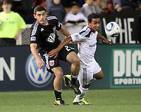Chris Kolb (22) of D.C. United  tackles Miguel Lopez (25) of the Los Angeles Galaxy during an MLS match at RFK Stadium, on April 9 2011, in Washington D.C.The game ended in a 1-1 tie.