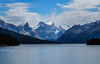 Beautiful Maligne Lake at Jasper National Park Alberta Canada. Blue skies, white clouds and deep blue water
