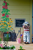 Childrens garden teaching house with painted signs and mannequins, Yarmouth Maine