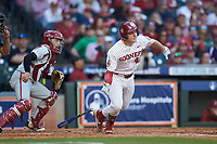 Brady Lindsly (40) of the Oklahoma Sooners follows through on his swing against the Arkansas Razorbacks in game two of the 2020 Shriners Hospitals for Children College Classic at Minute Maid Park on February 28, 2020 in Houston, Texas. The Sooners defeated the Razorbacks 6-3. (Brian Westerholt/Four Seam Images)