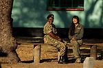 Cheetah (Acinonyx jubatus) conservationist, Kim Young-Overton, talking with park warden, Miriam Namushi, Kafue National Park, Zambia