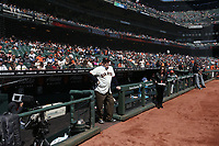 """SAN FRANCISCO, CA - APRIL 8:  John """"The Count"""" Montefusco of the San Francisco Giants stands on the dugout steps waiting for a pre-game ceremony before the game against the Los Angeles Dodgers at AT&T Park on Sunday, April 8, 2018 in San Francisco, California. (Photo by Brad Mangin)"""