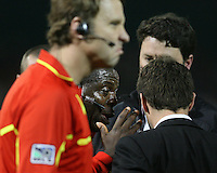 Ben Olsen of D.C. United argues with referee Abiodun Okulaja  during an MLS match against the Los Angeles Galaxy at RFK Stadium, on April 9 2011, in Washington D.C. The game ended in a 1-1 tie.