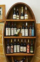 In the winery wine shop, display of various wines from the Medugorje region: Zadro, Domano, Gangas, Ostojic. Dzajo, Katarina, KRS, Obiteljska... Podrum Vinoteka Sivric winery, Citluk, near Mostar. Federation Bosne i Hercegovine. Bosnia Herzegovina, Europe.