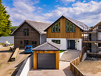 BNPS.co.uk (01202 558833)<br /> Pic: ShorePartnership/BNPS<br /> <br /> Pictured: The garage and front steps to the house.<br /> <br /> A brand new waterfront home perfect for paddleboarders is on the market for £1.3m.<br /> <br /> Creek View is built on a former boatyard and has direct water access to Restronguet Creek from steps in the back garden.<br /> <br /> The contemporary four-bedroom house has an open-plan living space and floor-to-ceiling glass overlooking the water to make the most of its stunning location.