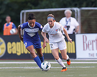 Sky Blue FC midfielder Manya Makoski (22) works to clear ball as Boston Breakers forward Lianne Sanderson (10) closes. In a National Women's Soccer League (NWSL) match, Boston Breakers (blue) defeated Sky Blue FC (white), 3-2, at Dilboy Stadium on June 30, 2013.