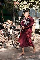 Myanmar, Burma, Mandalay.  Barefoot Buddhist Monk Walking.