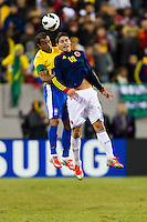 James Rodriguez (10) of Colombia goes up for a header with Lucas (17) of Brazil. Brazil (BRA) and Colombia (COL) played to a 1-1 tie during international friendly at MetLife Stadium in East Rutherford, NJ, on November 14, 2012.
