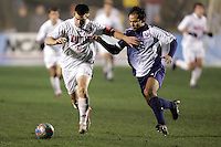 Maryland's Jason Garey (left) holds off SMU's Mynor Gonzalez (right). The University of Maryland defeated Southern Methodist University 4-1 in the NCAA Semifinal at SAS Stadium in Cary, North Carolina, Friday, December 9, 2005.