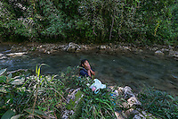 25 noviembre 2014. Otilia Cuzbo lava la ropa en el río Canlich porque no tiene agua en casa. En Cobán (Guatemala) la hidroeléctrica española Renace se ha instalado con amenazas a la población y falsas promesas de desarrollo para la zona. La compañía también ha prohibido el acceso al río Cahabón para miles de personas y no ha respetado la estrecha relación de los indios mayas con el medio ambiente. Renace es una empresa guatemalteca, pero ha dado el contrato de la construcción de la hidroeléctrica a la empresa española Cobra (FCC). El proyecto ha dividido a la población entre partidarios y detractores. ©Calamar2/ Pedro ARMESTRE<br /> <br /> <br /> Otilia Cuzbo washes the clothes in the Canlinch river because she doesn' t have water at home. In Coban, place located in Guatemala, the hydroelectric Renace has been installed with threats to the population and false promises of development for the area. The company has also forbidden the access to the river for thousands of people and has no respected the close relationship of the Maya Indians with environment. Renace is a Guatemaltecan company but has given the contract of the  construction of the hydroelectric to the spanish company Cobra. The project has divided the population and has caused riots. The project has very close families that live in extrem poverty. They are people that leave close to the hydroelectric but they don' t have electricity at home. ©Calamar2/ Pedro ARMESTRE