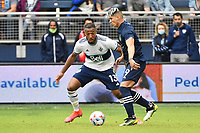 KANSAS CITY, KS - MAY 16: Alan Pulido #9 Sporting KC with the ball watched by Derek Cornelius #13 Vancouver Whitecaps during a game between Vancouver Whitecaps and Sporting Kansas City at Children's Mercy Park on May 16, 2021 in Kansas City, Kansas.
