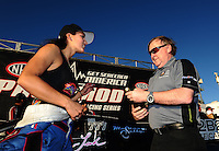 Oct. 30, 2011; Las Vegas, NV, USA: NHRA pro mod driver Leah Pruett (left) celebrates with team owner Roger Burgess after winning the Big O Tires Nationals at The Strip at Las Vegas Motor Speedway. Mandatory Credit: Mark J. Rebilas-