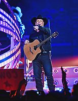 """20 June 2020 - """"Garth Brooks: The Road I'm On"""" documentary follows Brooks' life and career as well as that of his wife Trisha Yearwood. File Photo: Garth Brooks performs on stage in 2016 at FirstOntario Centre, Hamilton, Ontario, Canada. Photo Credit: Brent Perniac/AdMedia"""