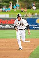 Grant Green (9) of the Salt Lake Bees hustles towards third base against the Tacoma Rainiers at Smith's Ballpark on July 9, 2014 in Salt Lake City, Utah.  (Stephen Smith/Four Seam Images)