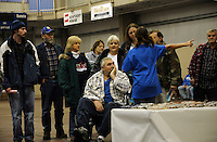 Barbara (centre) and Jessie McBee (in wheelchair), both 60, wait for an optician. Jessie had a stroke and heart attack in 2005 and is confined to a wheelchair. He has disability insurance but his wofe doesn't. Over the weekend at Soft Shell, Knott County, in the Appalachian mountains of eastern Kentucky, the congressional district with the nation's lowest life expectancy, RAM volunteers saw 822 needy people. 95 percent of people seen were provided with dental or optical care. RAM was founded in 1985 to provide free health, dental and eye care in the developing world. However, RAM now provides 60 percent of its services in the US, providing for the estimated 47 million Americans without health insurance...