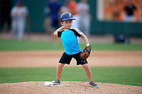 A young child throws out the first pitch before the second game of a doubleheader between the Lakeland Flying Tigers against the St. Lucie Mets on June 10, 2017 at Joker Marchant Stadium in Lakeland, Florida.  Lakeland defeated St. Lucie 9-1.  (Mike Janes/Four Seam Images)