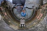 A Nepali man collects drinking water at Pashupati Nath temple in Kathmandu, Nepal