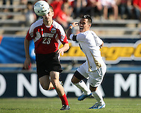 Anthony Ampaipaitakwong #10 of the University of Akron chases a loose ball with J.T. Murray #23 of the University of Louisville during the 2010 College Cup final at Harder Stadium, on December 12 2010, in Santa Barbara, California.Akron champions, 1-0.