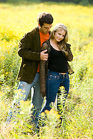 Couple embracing in front of goldenrod<br />