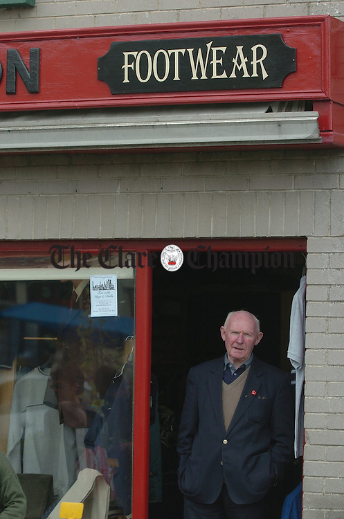 William Mc Cannon stands at the door of his shop in the Ennis market area on Saturday. He has been trading for thirty three of his fifty years as a mens outfitter at this premises. Photograph by John Kelly.